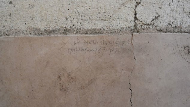 A charcoal inscription changes the date of the eruption that's been passed down through history