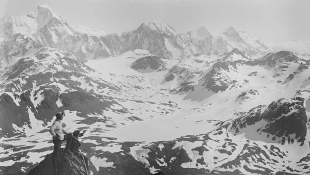 From-a-peak-on-South-Georgia-Island,-Frank-Worsley-and-an-expedition-member-peer-down-on-the-Endurance