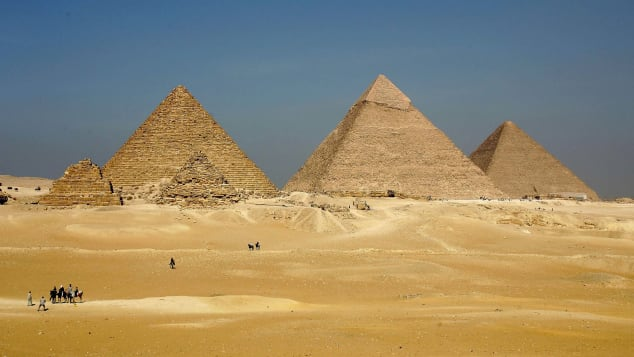 Three enormous pyramids loom over the horizon at Giza.