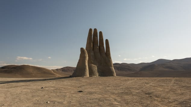 """Mano del Desierto,"" an unexpected sculpture in Chile's Atacama Desert, is 36 feet tall."