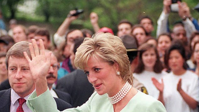 Princess Diana waves to cheering crowds as she visits Northwestern University in Chicago in June 1996.