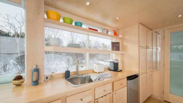 Inside the Vista, walls are all sheathed in pine; cabinets, drawers and shelves are built-in.