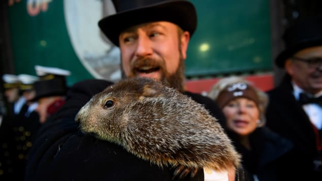 A.J. Dereume holds Punxsutawney Phil after he did not see his shadow Saturday on Groundhog Day.