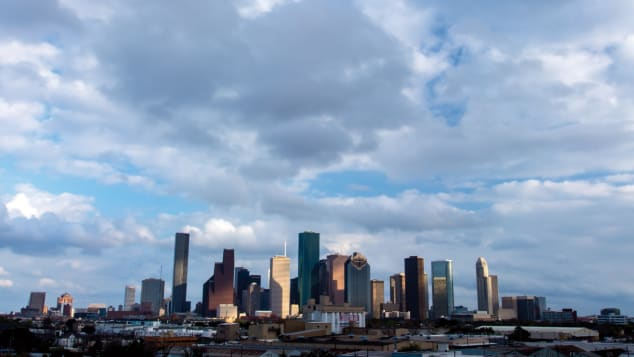 The downtown Houston skyline is dotted with skyscrapers in a variety of architectural styles.