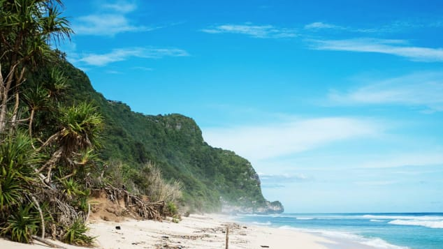 Bali's Nyang Nyang beach is a mile-long strip of golden sand, framed by jungled cliffs, green meadows and blue ocean.