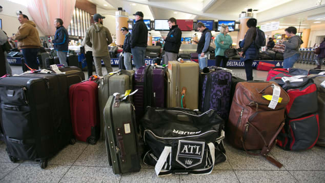 Passengers search for their luggage at Hartsfield-Jackson Atlanta International Airport.
