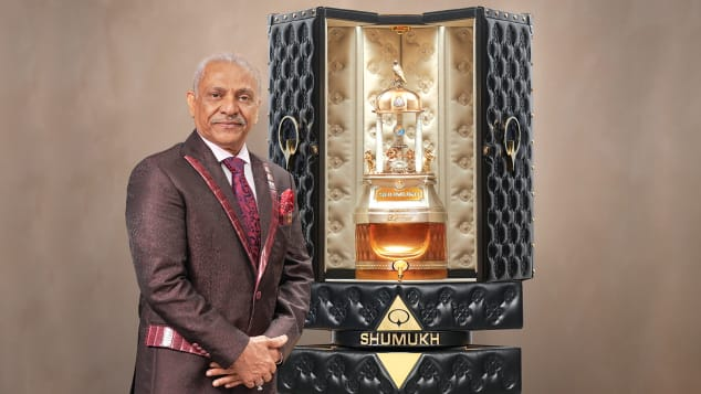 "Founder and chairman of Nabeel Perfumes Group Asghar Adam Ali stands next to the $1.295 million bottle of ""Shumukh."""