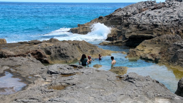 The Queen's Bath is a series of natural pools carved into rock by the pounding Atlantic.