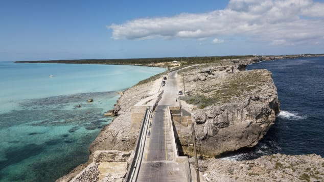 The Glass Window Bridge spans a sliver of land separating the deep blue Atlantic from the Bight of Eleuthera.