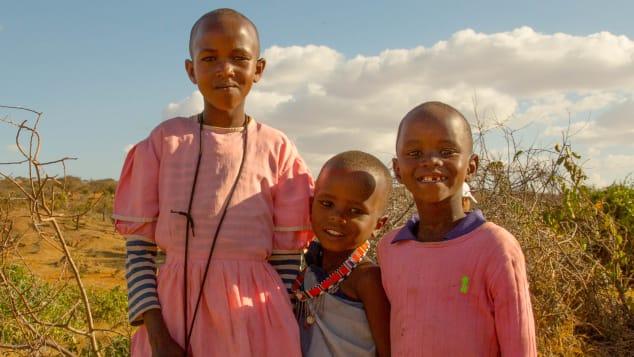 The village children enjoy posing for the cameras.