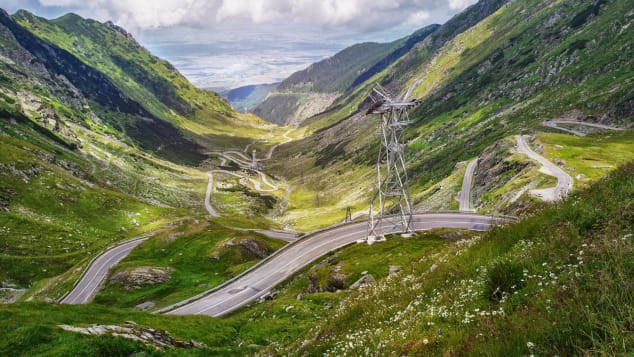 "Sometimes referred to as ""the road to the sky,"" the Transfăgărășan climbs from 1,630 feet to 6,700 feet."