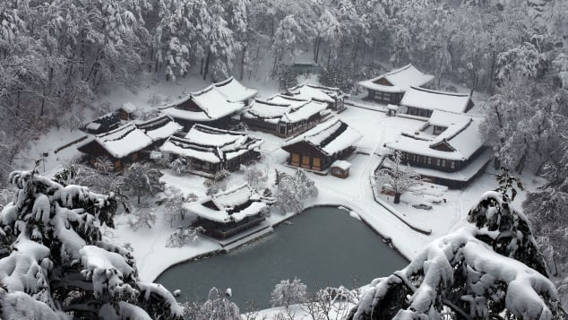 Snow blankets Bulyoungsa Temple in winter.