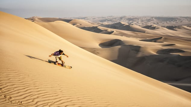 Sandboarding is similar to snowboarding but takes place on sand dunes.