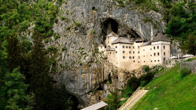 Predjama Castle is built into the mouth of a cliffside cave.