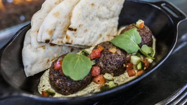 """Like many of Disney's food offerings, some of the vegan dishes are themed to match their location. This hummus dish served at Star Wars: Galaxy's Edge is called a """"Felucian Garden Spread,"""" a reference to a planet covered in overgrown plants in the Star Wars universe."""