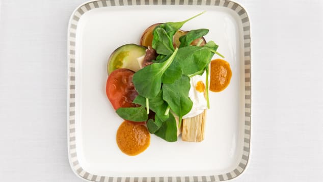 The heirloom tomato salad with cured ham, palm hearts, AeroFarms Arugula and spiced tomato dressing is currently being served on flights from Newark to Singapore.