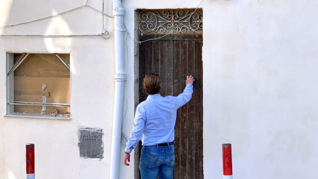 One-euro-home-buyers--Janssen-in-front-of-his-house-c-Patrick-Janssen