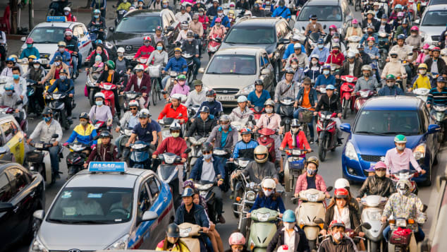 A common scene in the city of Hanoi, which is home to nearly six million motorbikes.
