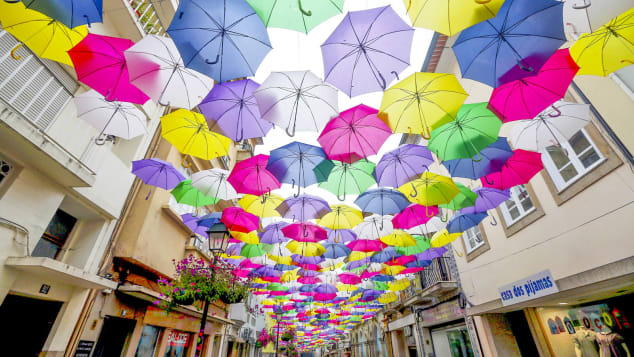 The umbrellas protest from summer heat and provide a colorful backdrop.