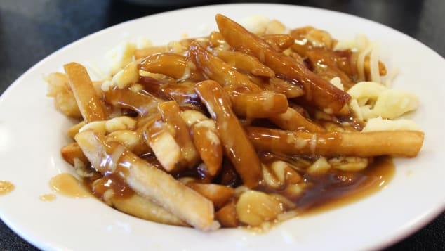 The almighty poutine is made up of fries, cheese curds and gravy.