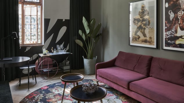 Stylishly mismatched furniture and mid-century modern accents are the name of the game at Gorgeous George.