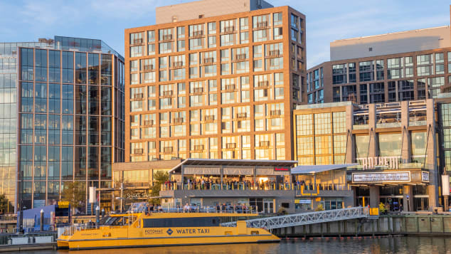 The Wharf riverfront development project is attracting dining, hotels and visitors. Shutterstock