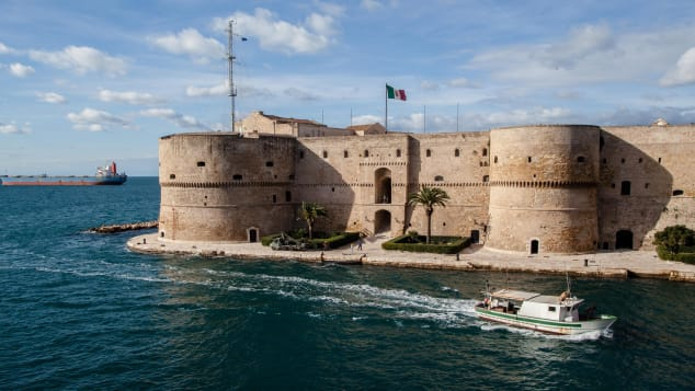 The coastal city of Taranto, Italy, home to the impressive Castello Aragonese, pictures, is offering up homes for a little over $1