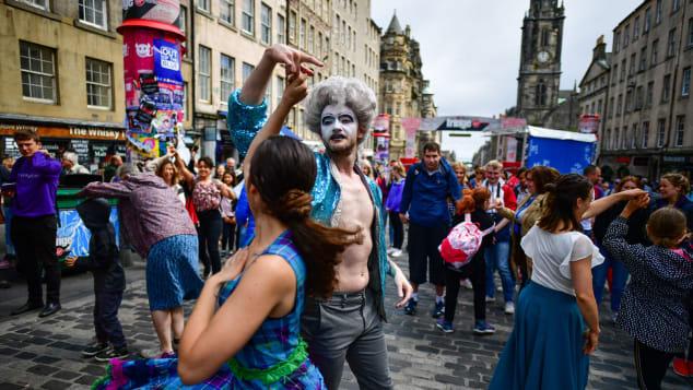 Fringe Festival Performers On Edinburgh's Royal Mile