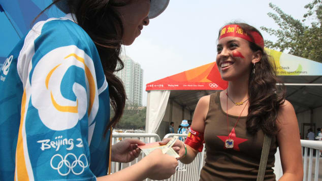 An American tourist presents a ticket at the 2008 Beijing Olympics.