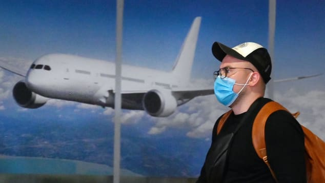On January 20, a masked traveler arrives in Kiev after flying in from China.