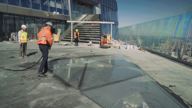 A picture taken during construction shows the glass floor in the center of the deck.