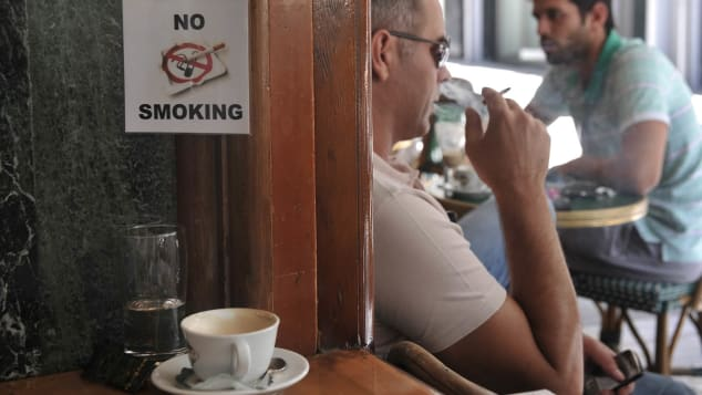 Fresh food, stale air -- al fresco cafes are still frequented by smokers.