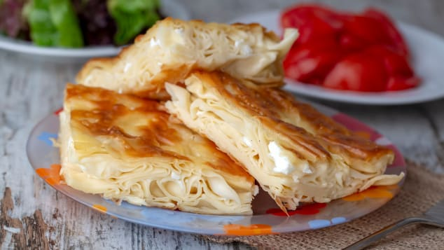 "This savory pastry is made by layering sheets of a dough named ""yufka"" and adding a filling of white cheese"