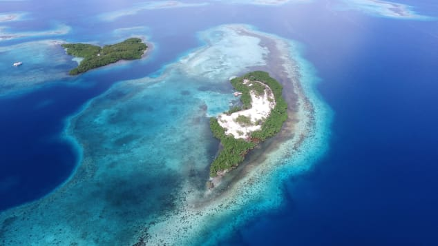 Won't you take me to Funk Caye town? This private island in Belize is one of the last available for sale in the region.