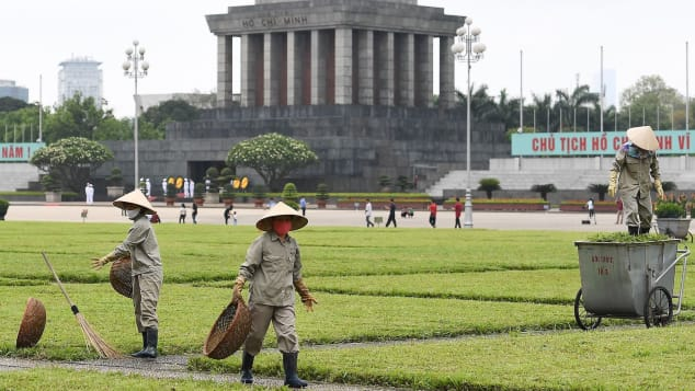 Municipal workers tend to the grass  outside the Ho Chi Minh mausoleum in Hanoi on May 13 as tourist spots began reopening.