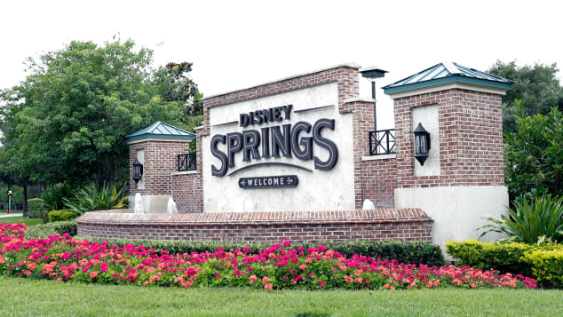 A sign near one of the entrances to Disney Springs is seen May 18, 2020, in Lake Buena Vista, Florida.