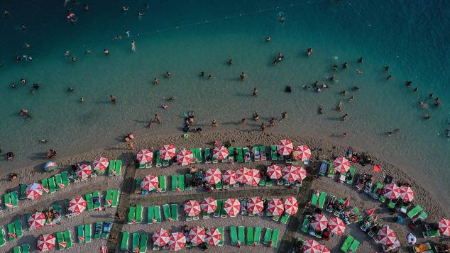 People enjoy the beach on August 16, 2019 in Oludeniz, Turkey.