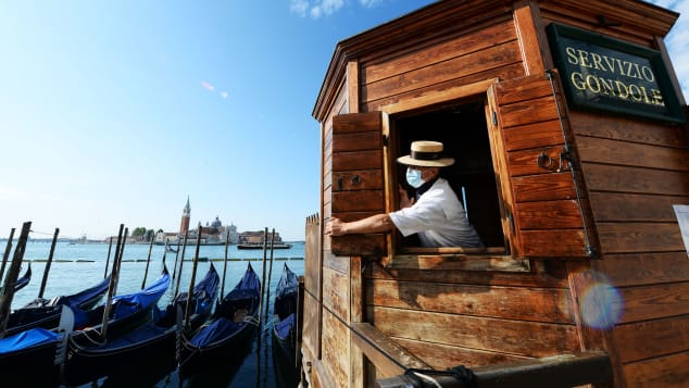 A gondoliere opens a kiosk for people wanting to go for a gondola ride in May.