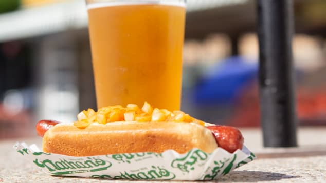 A visit to Coney Island in the summer nearly always involves hot dogs, and, frequently, beer.