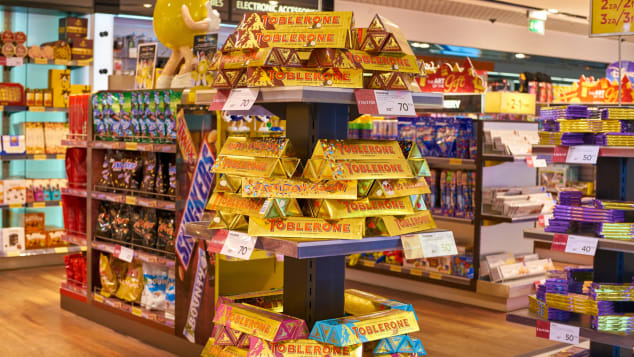 Bright yellow and gold wrapping also helps Toblerone stand out in airport shops.