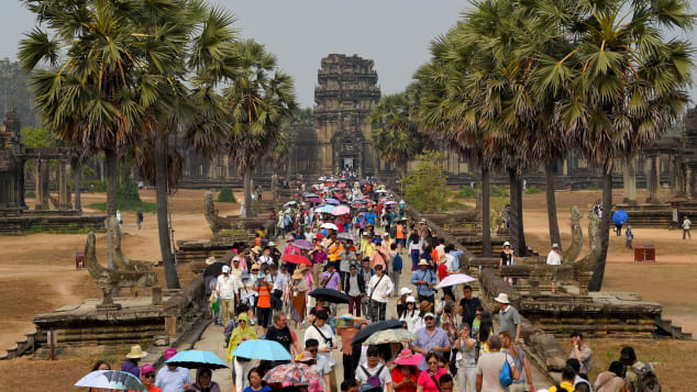 Tourists visit the Angkor Wat temple in Siem Reap province on March 16, 2019.