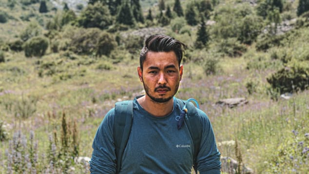 Pete Rojwongsuriya, a Thai travel blogger based in Thailand, at Ala Archa National Park in Kyrgyzstan.