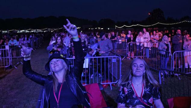 https://dynaimage.cdn.cnn.com/cnn/q_auto,w_634,c_fill,g_auto,h_357,ar_16:9/http%3A%2F%2Fcdn.cnn.com%2Fcnnnext%2Fdam%2Fassets%2F200813074850-restricted-03-social-distanced-music-festival-intl-scli-0811.jpg
