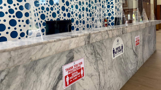 Social distancing signage and plexiglass barriers greet guests at Hedonism II in Jamaica.