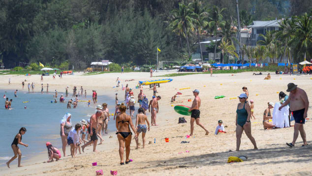 International tourists enjoy a Phuket beach in March, just weeks before the island locked down due to Covid-19.
