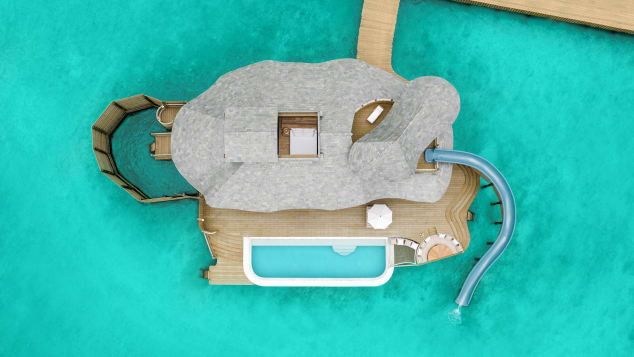 This aerial view shows the villa's pool and waterslide.