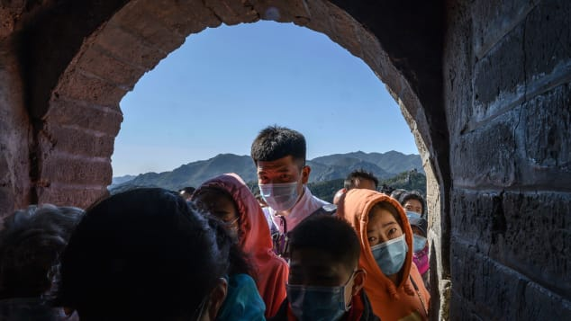 Chinese tourists crowd in a doorway on a section of the Great Wall on October 4.