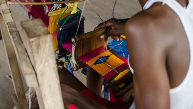 While it's often mass-produced, there are many folk weavers around the country who make kente cloths by hand.