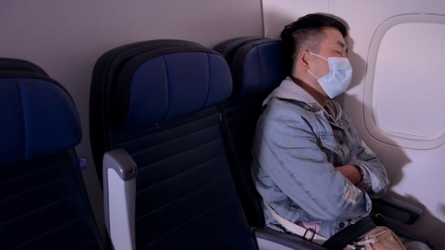 Wear a mask that covers your mouth and nose throughout your flight and stay seated as much as possible.