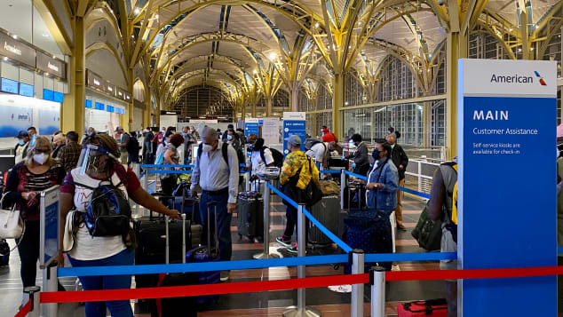 Maintaining 6 feet of social distance in airports can be challenging.